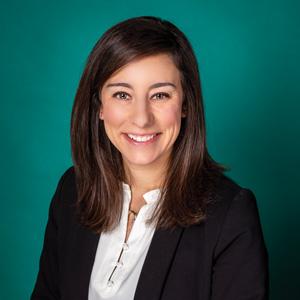 Professional headshot of female with short dark hair