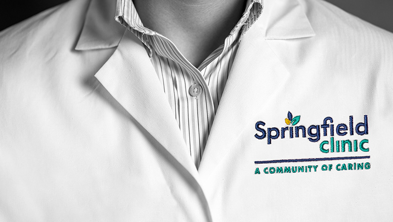 Closeup of white medical coat with Springfield Clinic logo