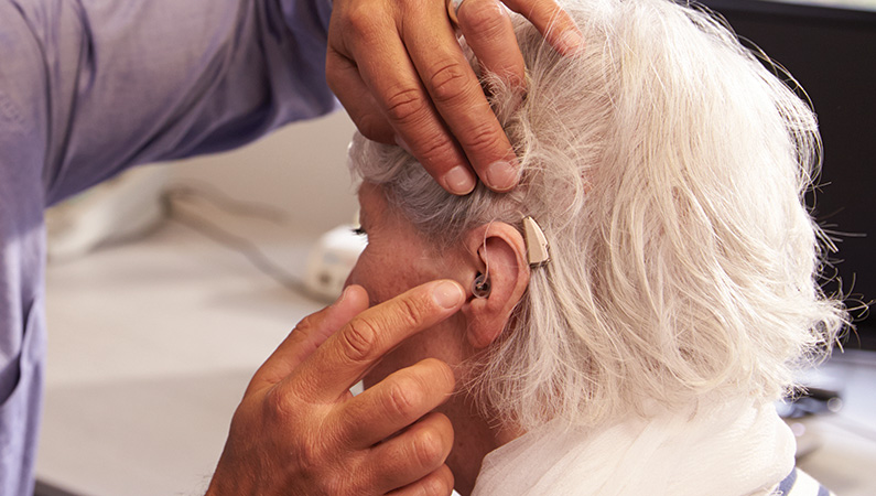 Patient getting ears and hearing aids checked