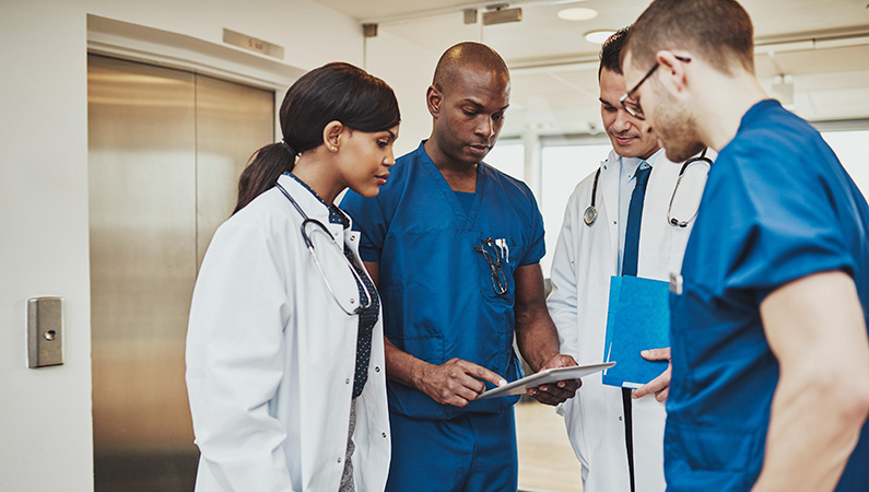 A group of medical professionals working together in a hospital setting.