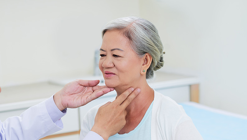 Older patient in medical office setting getting checked