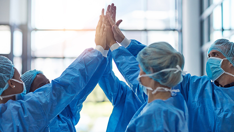 Group of medical professionals working together in hospital setting
