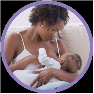 Mom breastfeeding new baby