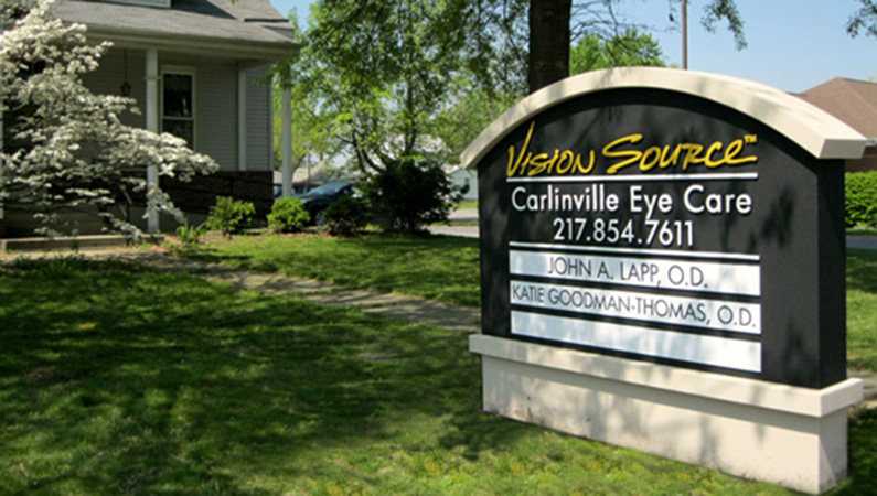 Black sign at the entrance of Carlinville Eye Care in Carlinville, Illinois