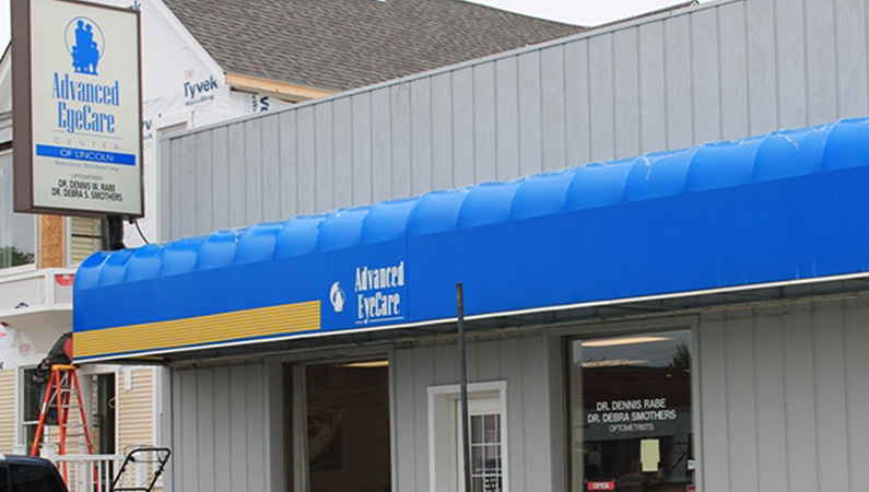 Exterior of medical office building with blue awning