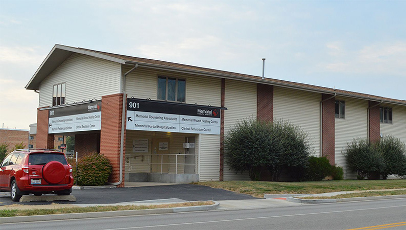 Exterior medical office building in Springfield, Illinois with yellow siding