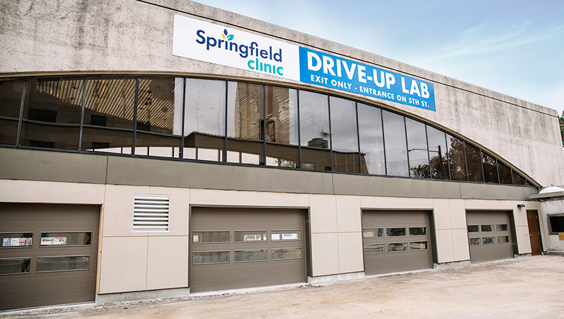 Drive-up laboratory facility with four garage doors