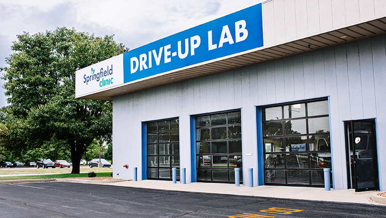 Exterior of drive-up laboratory facility with three garage doors in Springfield, Illinois