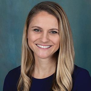 Female orthopedics nurse practitioner headshot.