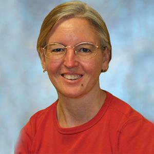 Female urgent care doctor headshot