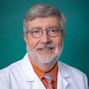 Male family medicine doctor headshot.