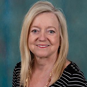 Female occupational medicine nurse practitioner headshot