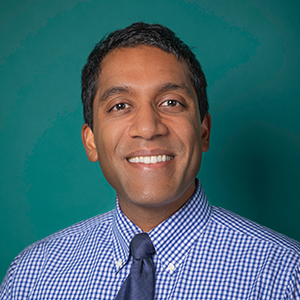 Male interventional spine care doctor headshot