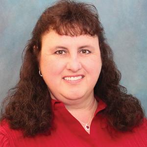 Female urgent care nurse practitioner headshot