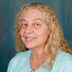 Female family medicine nurse practitioner headshot.
