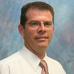 Male urgent care physician assistant headshot